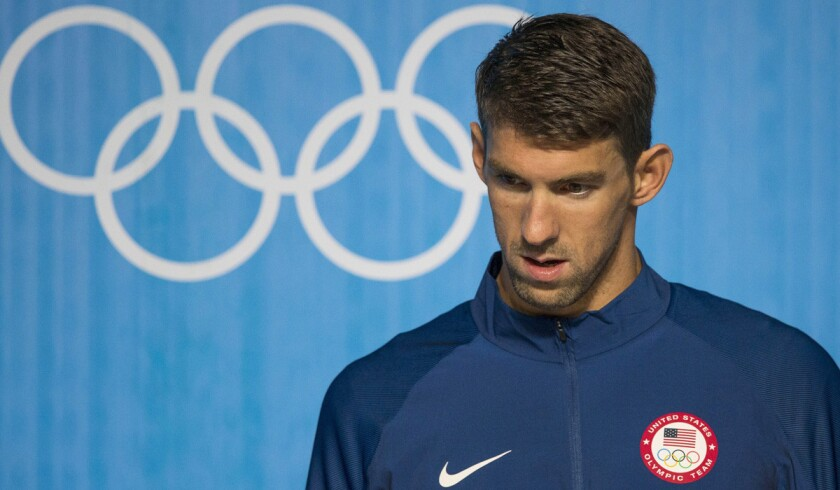 Michael Phelps arrives to a news conference at the Olympic Park in Rio de Janeiro on Wednesday.