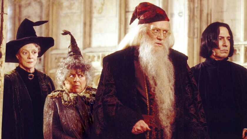 """From left: Professor McGonagall (Maggie Smith), Professor Sprout (Miriam Margoyles), Professor Dumbledore (Richard Harris) and Professor Snape (Alan Rickman) in Warner Bros. Pictures' """"Harry Potter and the Chamber of Secrets."""""""