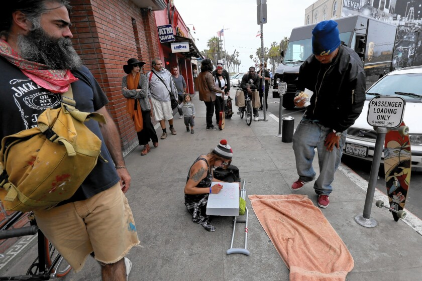 """Allison Holden, 23, center, sits on the Venice sidewalk where her friend Brendon Glenn was killed in an officer-involved shooting. """"He was a drinker. He has a drinking problem,"""" Holden told reporters. """"But we all have problems."""""""