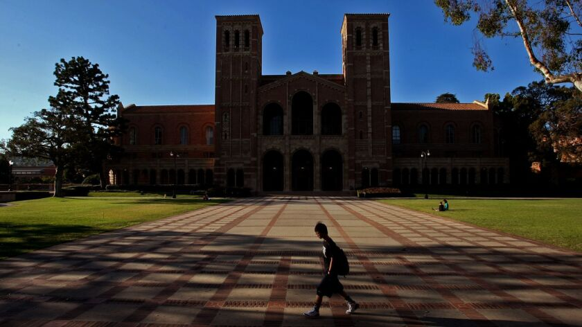 WESTWOOD, CA - AUGUST 7, 2013 -- A student walks in the courtyard in front of Royce Hall on the UCL