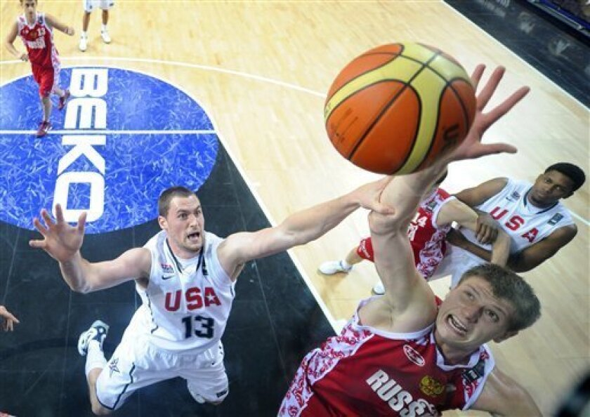 USA's Kevin Love, left, challenges Russia's Andrey Vorontsevich during the quarterfinal round at the World Basketball Championship, Thursday, Sept. 9, 2010, in Istanbul, Turkey. (AP Photo/Mark J. Terrill)