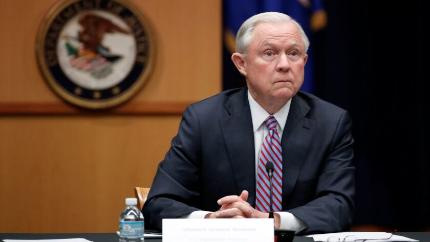 Attorney General Jeff Sessions listens to reporter's question before a meeting of the Attorney Gener