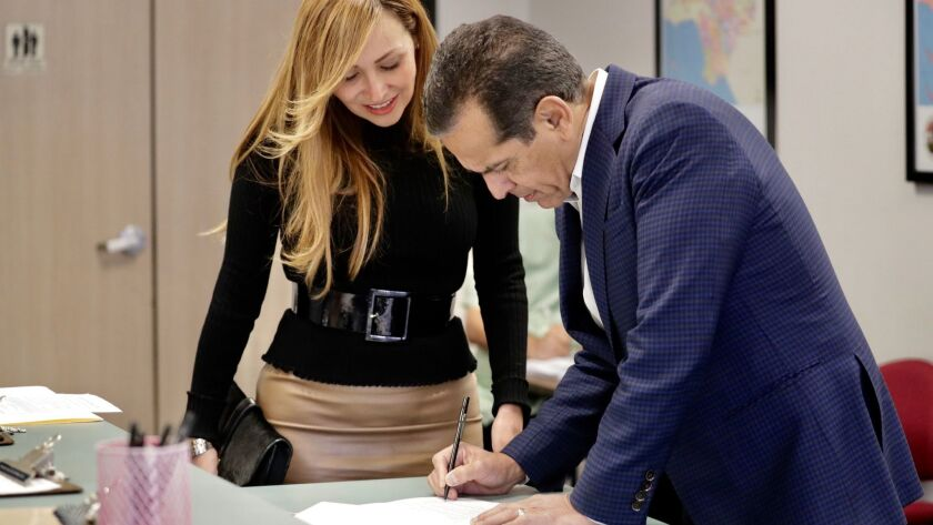 Former Los Angeles Mayor Antonio Villaraigosa, accompanied by his wife, Patty, files paperwork to officially place his name on the ballot as a candidate for governor at Los Angeles County Registrar-Recorder/County Clerk.