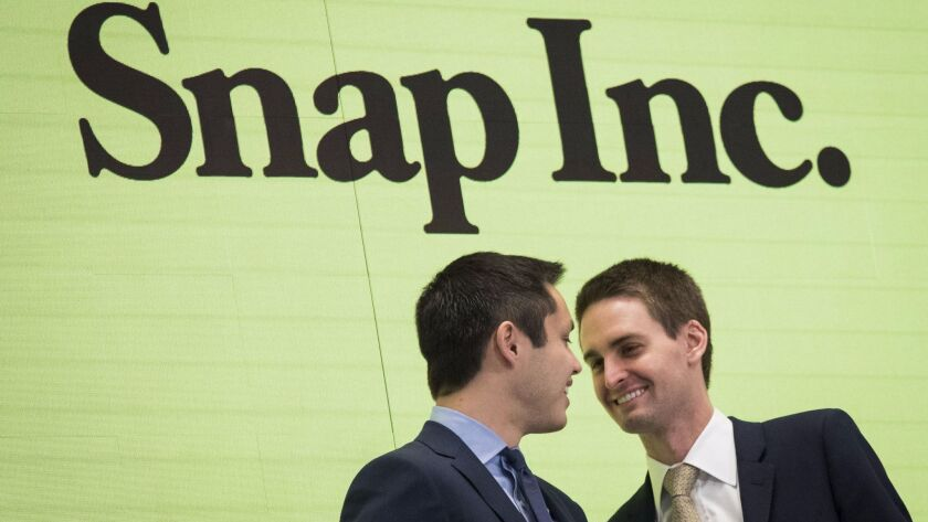 Snapchat co-founders Bobby Murphy and Evan Spiegel after ringing the opening bell at the New York Stock Exchange.