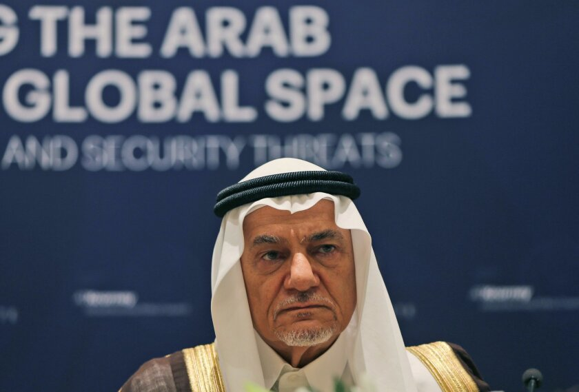 Former director of the Saudi Arabia General Intelligence Directorate, Prince Turki Bin Faisal Al Saud, and a member of the board of the Beirut Institute, talk during a press conference in Abu Dhabi, United Arab Emirates, Sunday, Feb. 21, 2016. The prominent Saudi prince said Sunday that Muslim countries need to take the lead in fighting terrorism and that a recently announced Islamic counterterrorism alliance of 34 nations should have been created sooner. (AP Photo/Kamran Jebreili)