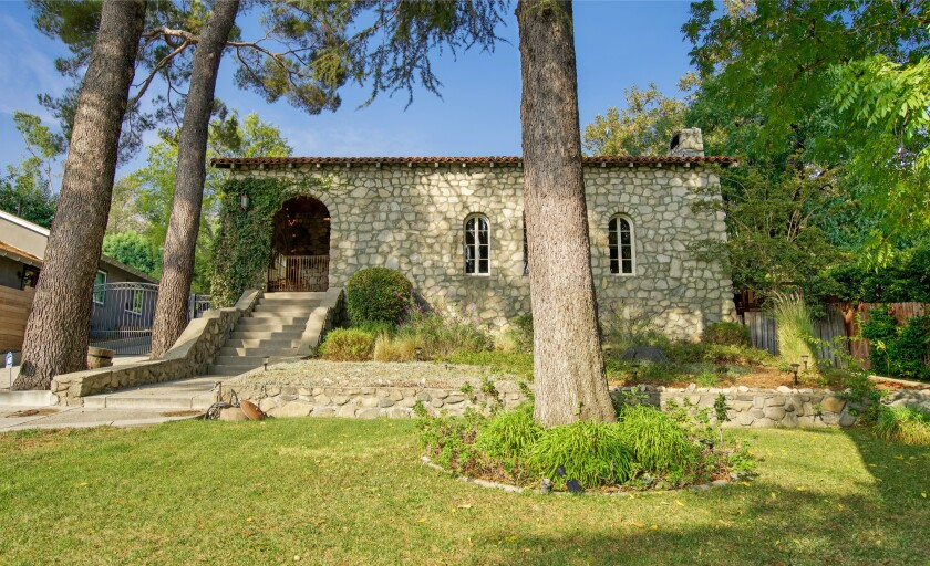 Built in 1936, the charming stone-clad home holds four bedrooms and five bathrooms in 2,800 square feet.