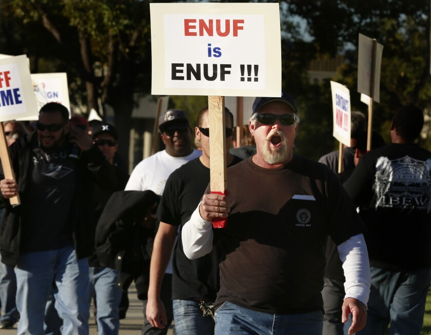 More than 300 members of the International Brotherhood of Electrical Workers rally on Feb. 10 at the Southern California Edison offices in Irvine in support of their fellow Edison employees and to protest what they say are unfair labor practices at the Southland's largest utility.