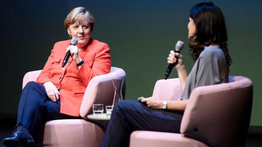 German Chancellor Angela Merkel, left, talks with the editor of Brigitte magazine, Brigitte Huber, a