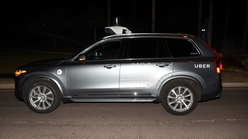 FILE - This file photo provided by the Tempe Police Department shows an Uber SUV after hitting a wom