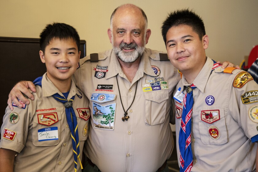 John McCutchen, shown with brothers Jack (left) and James Chang, was honored Sunday for his 25 years as a Scoutmaster for Boy Scouts of America.