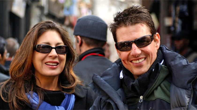 """THE PRODUCERS: Actor Tom Cruise, right, and his associate Paula Wagner on the set of """"Mission: Impossible III."""""""