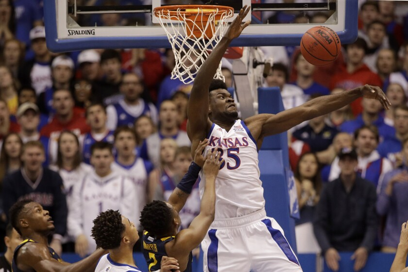 Kansas' Udoka Azubuike (35) blocks a shot during the first half of an NCAA college basketball game against West Virginia, Saturday, Jan. 4, 2020, in Lawrence, Kan. (AP Photo/Charlie Riedel)