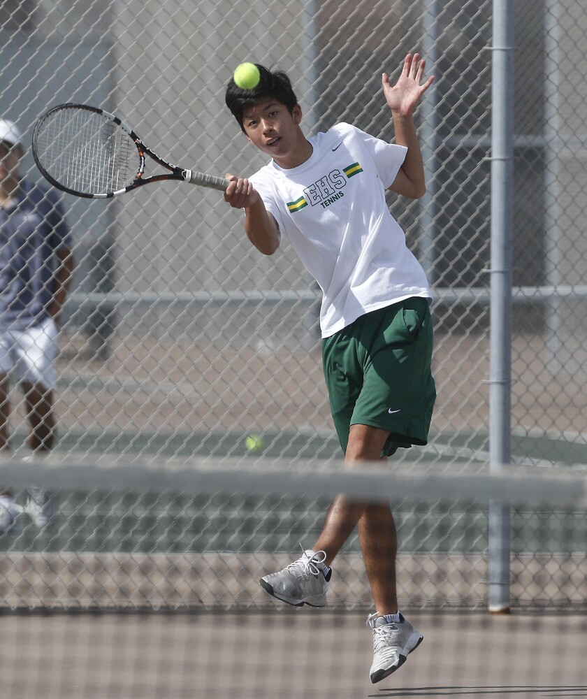 Edison High No. 1 doubles player Ryan Lum hits against Walnut in the quarterfinals of the CIF Southe