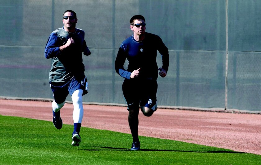 February 12, 2013_Peoria, AZ_|Pitchers Jason Marquis, left, and Tim Stauffer loosening up during the first day of Padres spring training Tuesday in Peoria, Arizona.| Bill Wechter/ U-T San Diego|_Mandatory Photo Credit:Bill Wechter/ U-T San Diego/Copyright 2012 San Diego Union-Tribune, LLC
