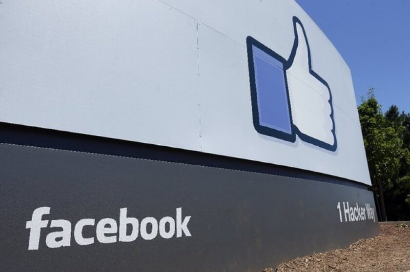 """A """"like"""" sign at Facebook headquarters in Menlo Park, Calif."""