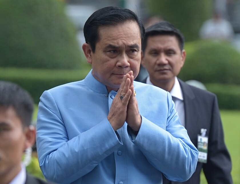 Thai prime minister and army chief Gen. Prayuth Chan-ocha gives a traditional greeting to the media before his first Cabinet meeting in Bangkok on Sept. 9.