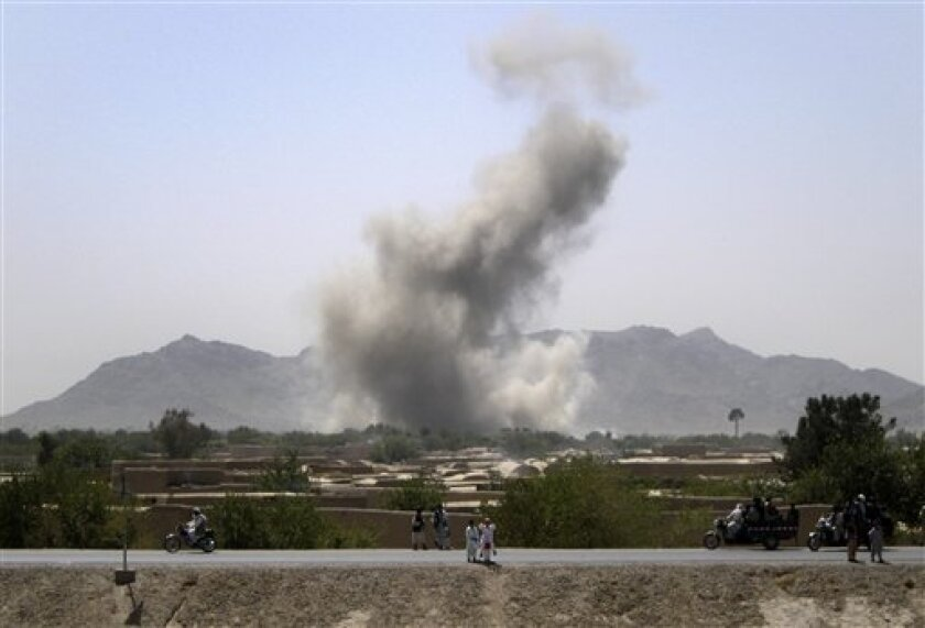 Smoke rises after NATO aircrafts conducted an air strike near the Arghandab river, south of Senjeray village, Kandahar province, where U.S. commanders had identified as insurgent positions Saturday, Sept. 11, 2010. (AP Photo/Todd Pitman)