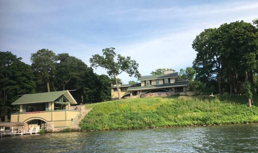 A view of Penwern from Delavan Lake. The rebuilt boathouse, left, was designed by architect Frank Lloyd Wright to sit below the sightlines of the house's patio so that it doesn't obstruct views of the lake.