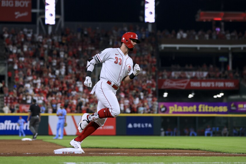Cincinnati Reds' Jesse Winker runs the bases after hitting a two-run home run during the seventh inning of the team's baseball game against the St. Louis Cardinals in Cincinnati, Saturday, July 24, 2021. (AP Photo/Aaron Doster)
