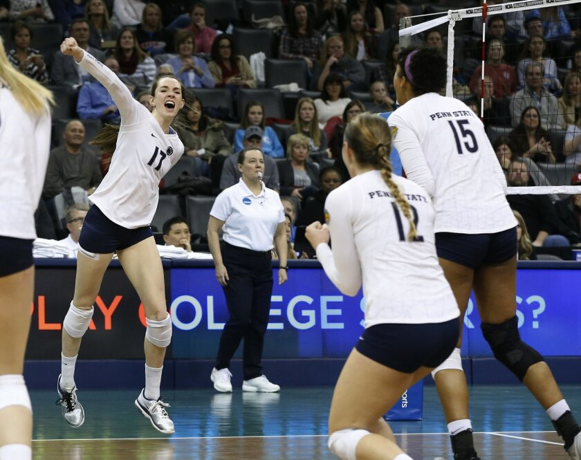 FILE - In this Dec. 20, 2014, file photo, Penn State's Megan Courtney (17) celebrates with teammates Micha Hancock (12) and Haleigh Washington (15) after scoring a point during the NCAA women's volleyball tournament championship match against BYU in Oklahoma City. Even after losing 2014 national player of the year Inky Ajanaku to a season-ending injury, Stanford is the main threat to a Penn State program that has won six of the last eight national championships. (AP Photo/Sue Ogrocki, File)