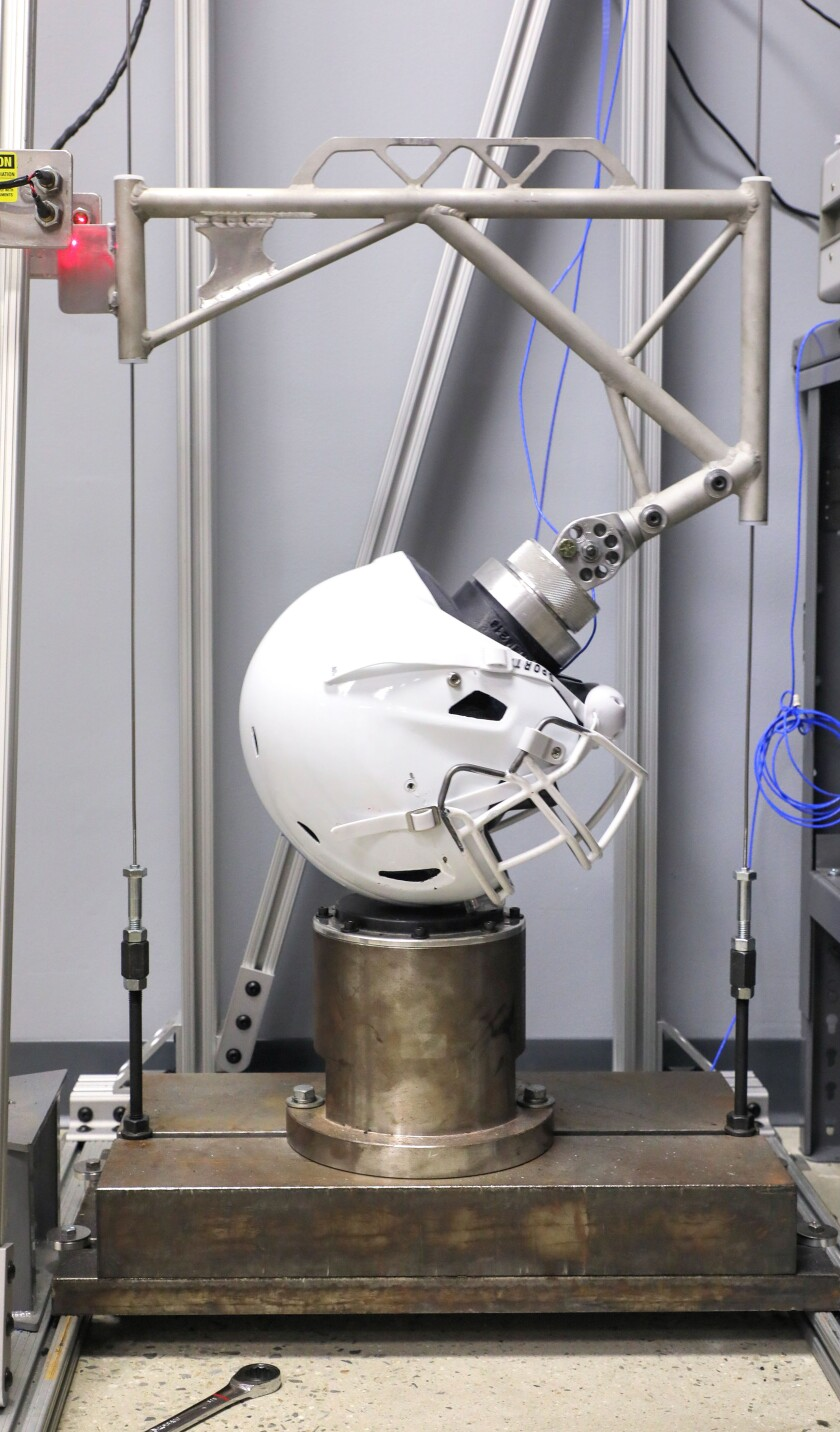At Light Helmets one of the company's helmets is tested for impact by a drop system testing device for NOCSAE certification.