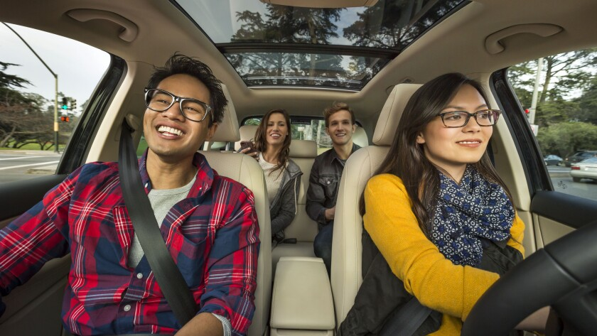 Commercial carpooling is growing in popularity in Los Angeles, rideshare companies Lyft and Uber say.
