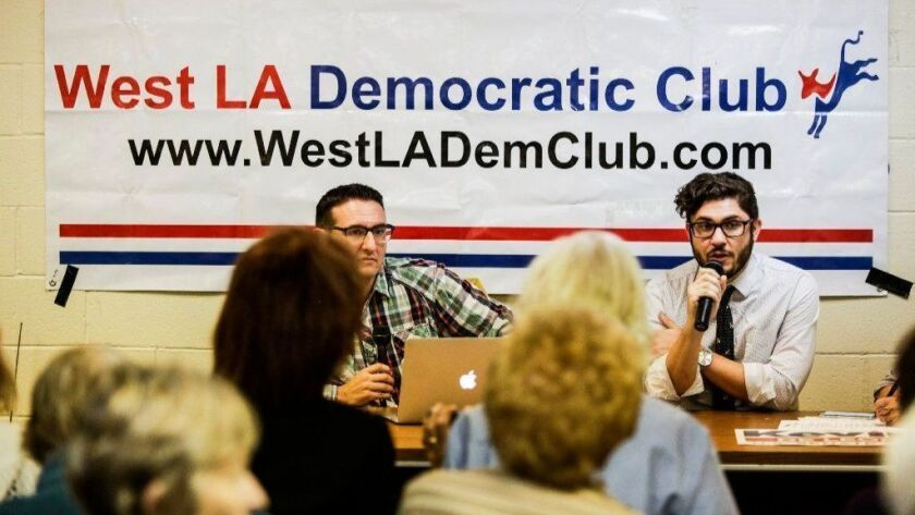 David Jette, right, legislative director of the advocacy group Public Bank L.A., speaks in favor of Measure B at a West Los Angeles Democratic Club meeting last month.