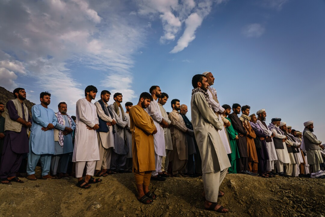 Islamic prayers are recited for the dead before they are buried Monday.
