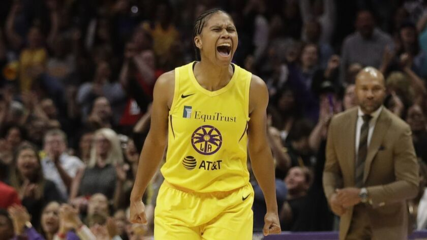 Los Angeles Sparks' Riquna Williams celebrates after a teammate scored against the Connecticut Sun d