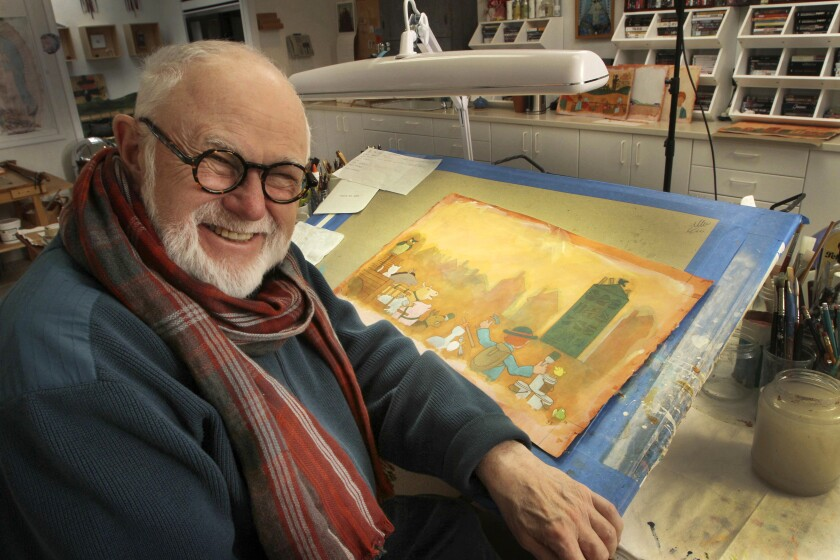 Tomie dePaola poses with his artwork in his studio in New London, N.H. The widely-loved children's author and illustrator died March 30 in New Hampshire. He was 85.