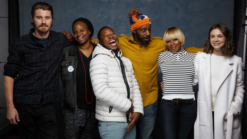 "Actor Garrett Hedlund, from left, director Dee Rees, actor Jason Mitchell, actor Rob Morgan, musician Mary J. Blige and actress Cary Mulligan from the film ""Mudbound,"" in the L.A. Times photo studio during the Sundance Film Festival in Park City, Utah, on Saturday."