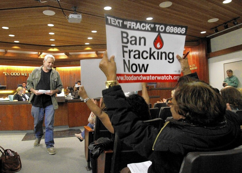 Glenn White leaves the lectern after speaking against new oil and gas production in Carson at a City Council meeting Tuesday.