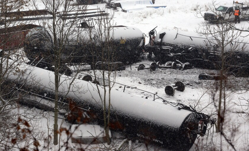 Cars are seen from a freight train derailment on Feb. 13, 2014, in Vandergrift, Pa.