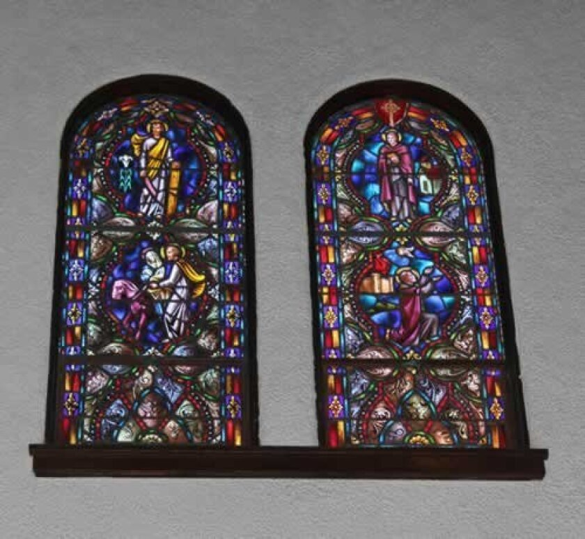 Two of 18 upper-level stained glass windows at St. James by-the-Sea church that will require restoration.