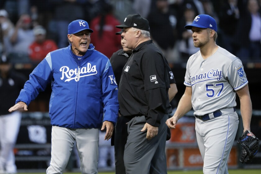 FILE - In this May 29, 2019, file photo, Kansas City Royals manager Ned Yost, left, appeals to umpire crew chief Bill Miller, center, after home plate umpire Mark Carlson ejected starting pitcher Glenn Sparkman (57) for hitting Chicago White Sox's Tim Anderson with a pitch during the second inning of a baseball game, in Chicago. Royals manager Ned Yost will be retiring at the end of the season, a year in which his team lost 100 games. His decision was announced by the team Monday, Sept. 23, 2019. (AP Photo/Charles Rex Arbogast, File)