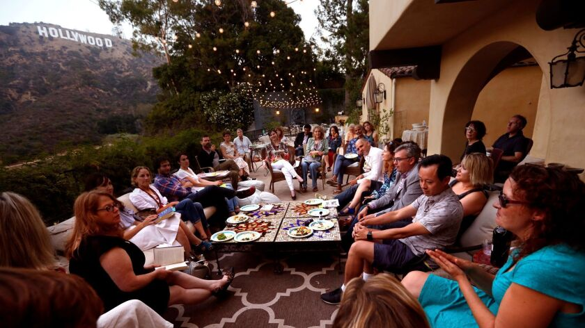 """A book club meets on the terrace of Aldous Huxley's home to discuss """"Brave New World."""""""