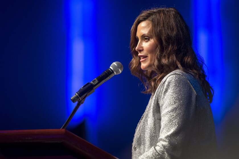 Michigan Gov. Gretchen Whitmer speaks during the Detroit Branch NAACP's 66th Annual Fight For Freedom Fund Dinner at TCF Center in Detroit on Sunday, Oct. 3, 2021. (Nic Antaya/Detroit News via AP)