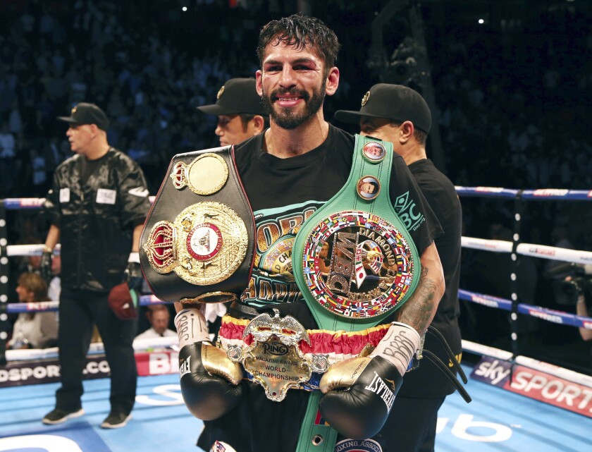 Jorge Linares poses with his belts after beating Anthony Crolla on Sept. 24, 2016.