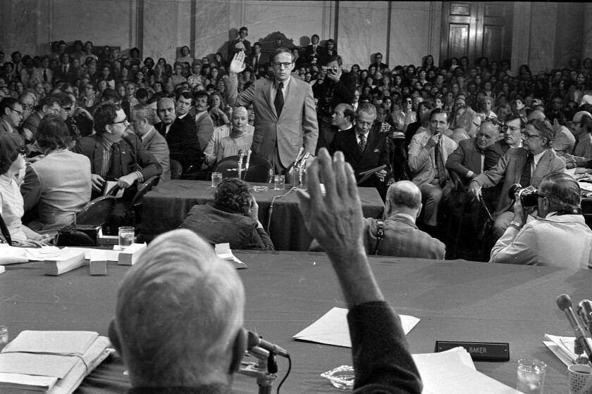 Former White House aide John Dean III is sworn in by Senate Watergate Committee Chairman Sam Ervin, in this June 25, 1973, file photo.