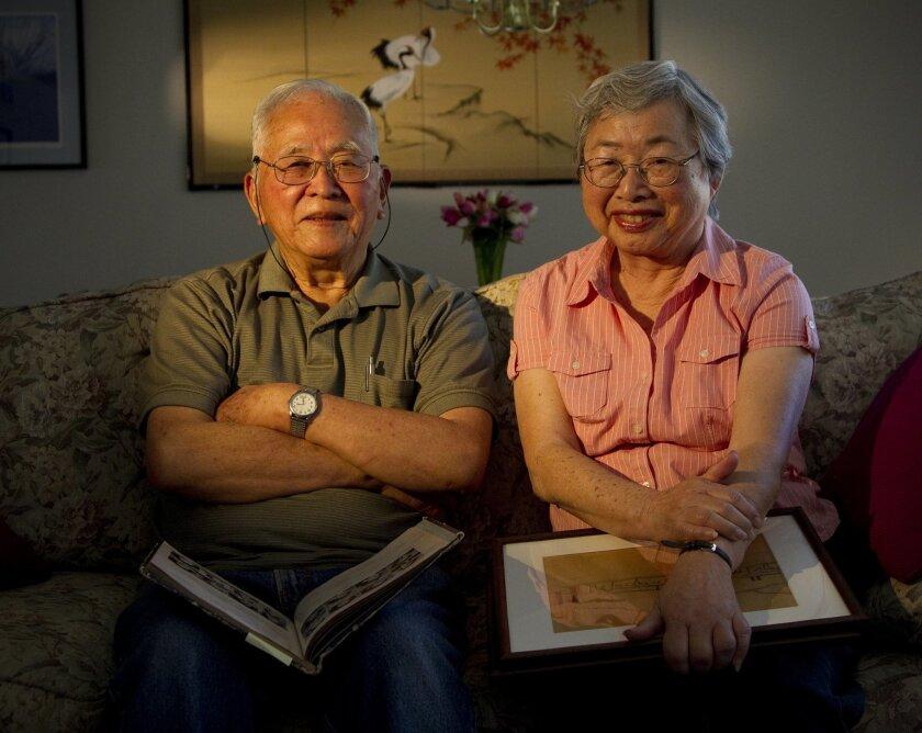 At their home near SDSU, Yukio Kawamoto and Mitsuko Kawamoto hold keepsake items from when they lived at the Poston War Relocation Camp in Arizona.