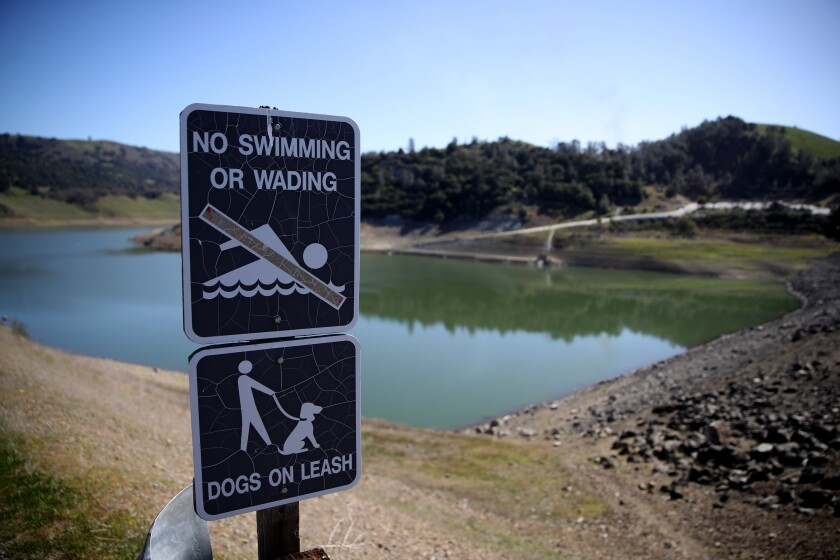 """A """"no swimming"""" sign is posted at Anderson Reservoir in Morgan Hill, Calif."""