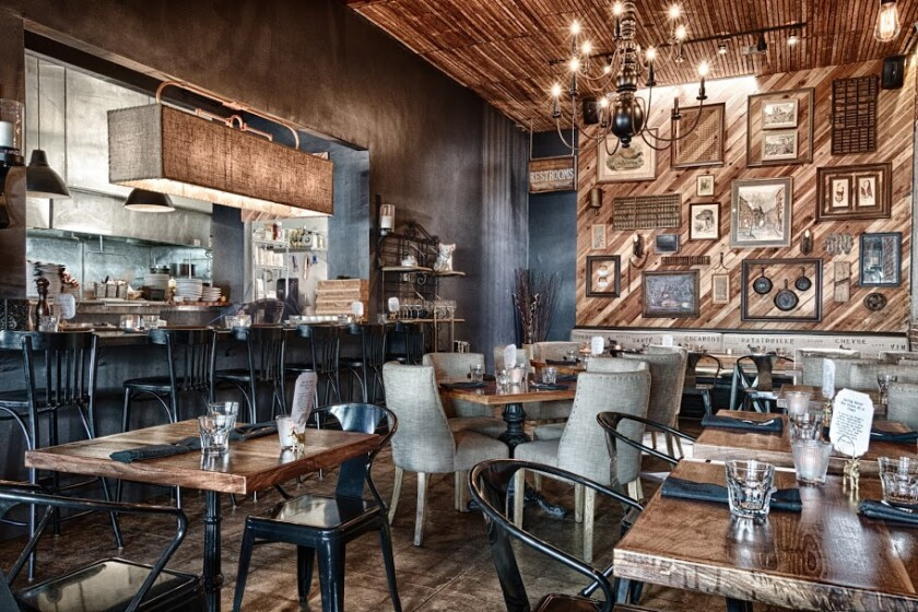 The warm and inviting dining room at North Park's The Smoking Goat is the perfect place to enjoy the change of seasons, San Diego style.