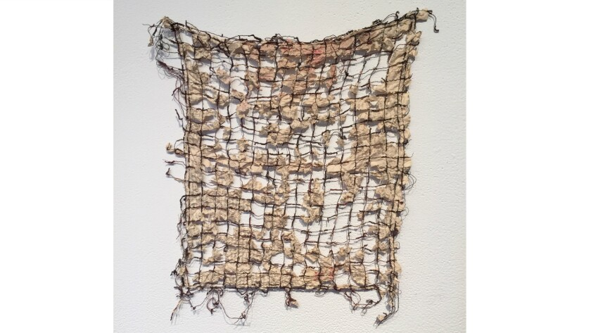Untitled work in paper and thread by Joan Weinzettle.