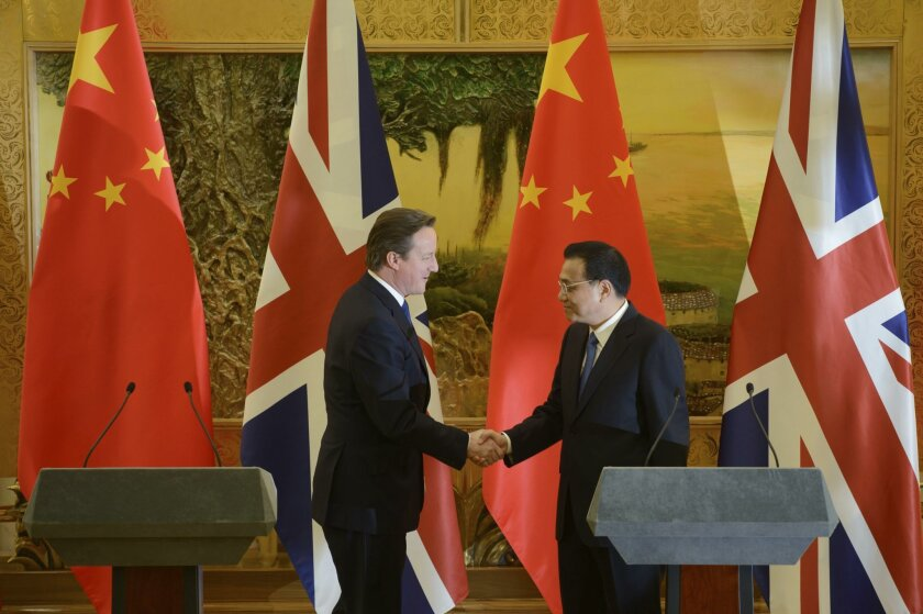 Britain's Prime Minister David Cameron, left, and China's Premier Li Keqiang shake hands after delivering their statements at the Great Hall of the People in Beijing, China, Monday, Dec. 2, 2013. (AP Photo/Ed Jones, Pool)