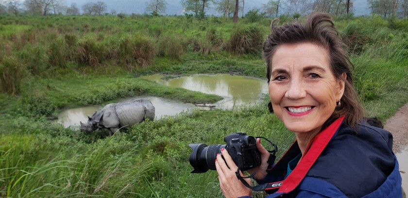 Author Georgeanne Irvine, shown photographing a greater one-horned rhino.