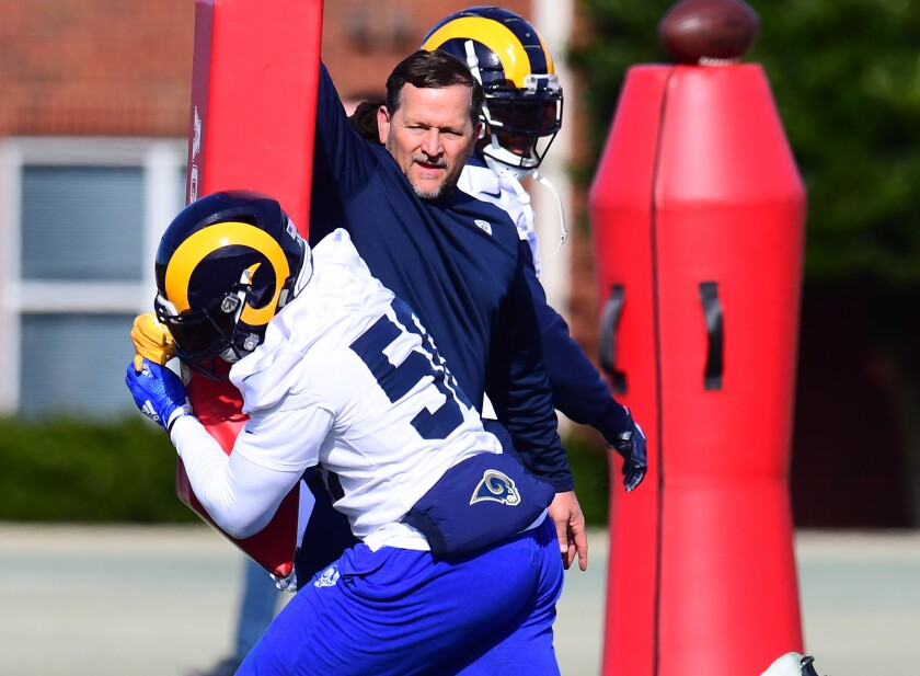 Rams linebacker coach Joe Barry works with Cory Littleton during a practice.