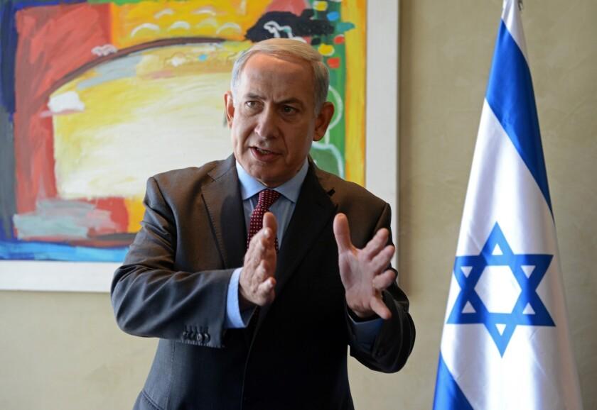 Israeli Prime Minister Benjamin Netanyahu speaks to reporters after his meeting with U.S. Secretary of State John F. Kerry at Ben Gurion Airport near Tel Aviv.