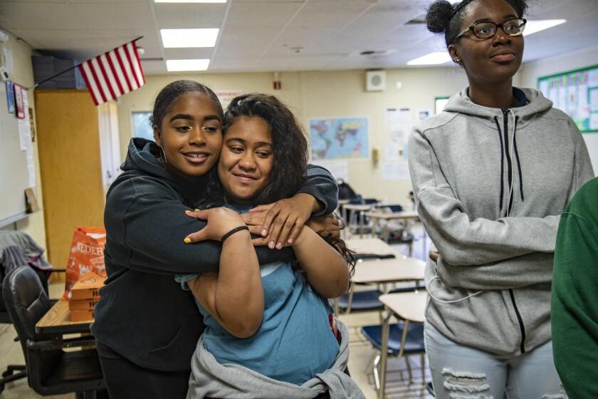 HARBOR CITY, CA - MAY 1, 2019: Nia Burton,17, left, hugs Ananaiah Fiaseu, 17, as they wait to hear i