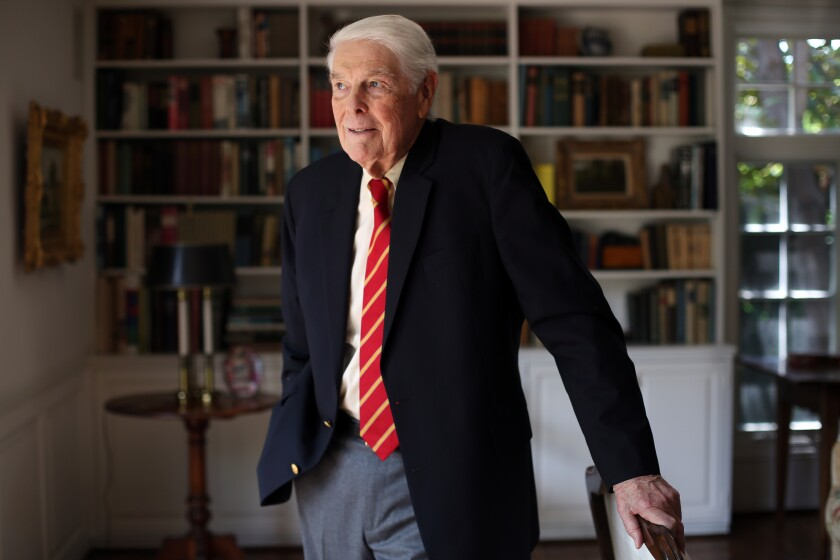 Tom Capehart, an 85-year-old graduating senior athlete from USC, poses for a portrait at home in Pasadena on May 13.