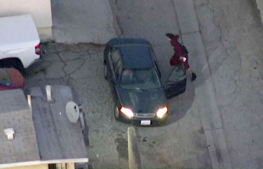 A man runs from a vehicle during a police pursuit that ended in San Pedro early Thursday.